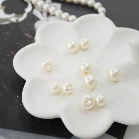5ea) pearl buttons (2 species)