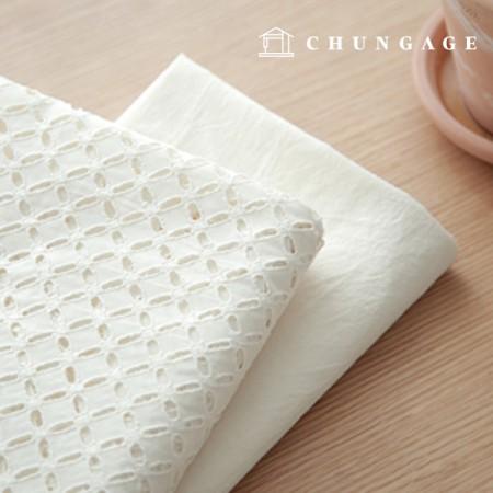 Cotton Race embroidery fabric pinwheel natural